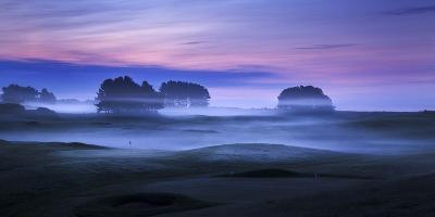 Spring Mist Lies in Cold Undulating Valleys across Greens and Fairways at Delamere Forest Golf Club