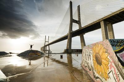 The Colorful Murals around Vasco Da Gama Bridge Emphasize its Architecture and Atmosphere at Dawn