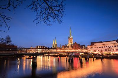 The Lights of Dusk on Typical Bridge and the Cathedral Reflected in River Trave, Lubeck