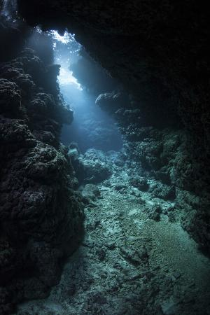 Sunlight Descends Underwater and into a Crevice in a Reef in the Solomon Islands