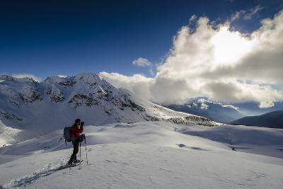 A Hiker Photographing the Winter Landscape (Val D'Ayas, Valle D'Aosta)