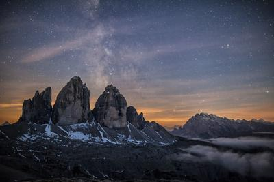 The Milky Way with its Stars Appear in a Summer Night on the Three Peaks of Lavaredo. Dolomites