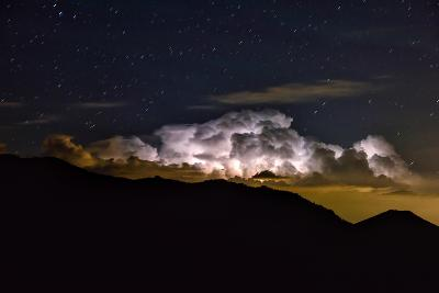 Storm Cloud Looms over the Mummy Range on a Starry Night in Rocky Mountain National Park