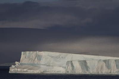 An Iceberg Illuminated by Early Morning Light Near the Antarctica Peninsula