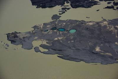 An Aerial View of Black Sand Peninsula with Deep Blue Crater Lakes in Southern Iceland