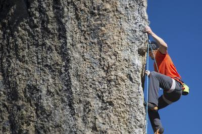 Male Climber Ascending Rock at Cirque of the Unclimbables
