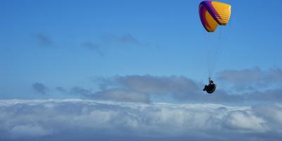 Paraglider Above the Clouds