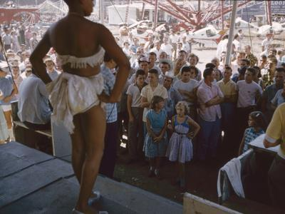 Audience Gathers to Watch a Dancer in a Two-Piece Costume at the Iowa State Fair, 1955