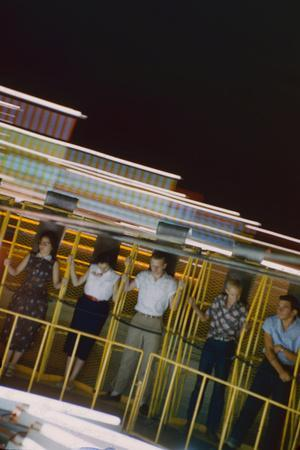 Fairgoers on a 'Round-Up' Spinning Amusement Ride at the Iowa State Fair, Des Moines, Iowa, 1955