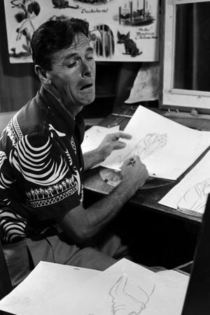 """A Disney Artist-Animator Works on a Drawing from """"Lady and the Tramp,"""" Burbank, CA, 1953"""
