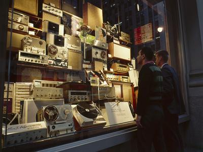 Young Men Men Look at a Window Display of Stereo and Recording Equipment, New York, NY, 1963