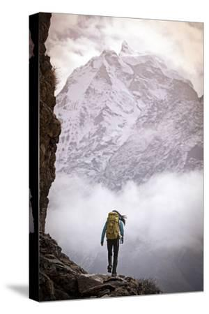 A Woman Climbing in the Khumbu Region of the Himalaya Mountains