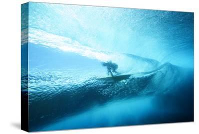 Underwater View of a Surfer with a Surfboard