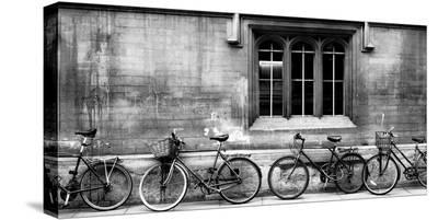 A Row of Bikes Leaning Against an Old School Building in Oxford, England