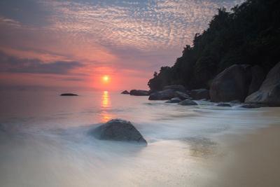 Long Exposure of a Colorful Sunrise Above Praia Do Cedrinho Beach