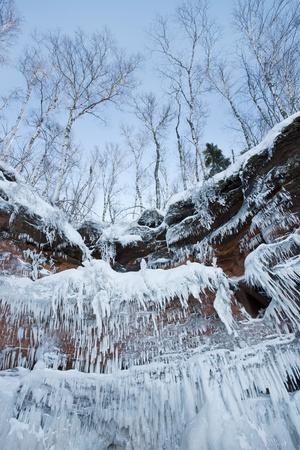 Icicles Hanging From Sandstone Cliffs On Shoreline