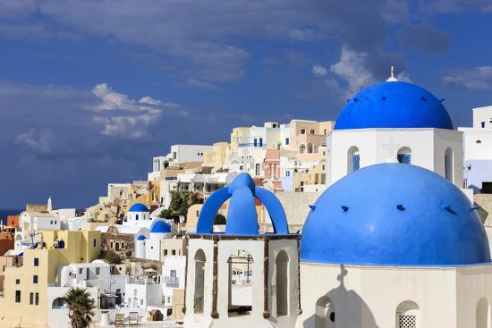 Blue Roofed Churches Cities Embrace The Steep Mountain Sides Santorini Greece Photographic Print Tom Norring Allposters Com