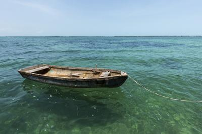 A Dingy Floats by Itself on Open Green Waters Near the Southern Coast of Cuba