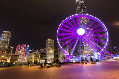 Hong Kong, China. Night Skyline with New Ferris Wheel and Twilight , Purple