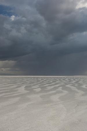 Utah. Passing Thunderstorm over Bonneville Salt Flats, Leaving Flooded Desert Floor