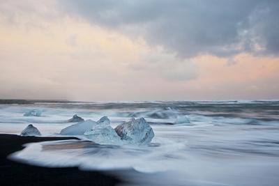 Europe, Iceland, Jokulsarlon Glacier Lagoon. Waves Wash Beached Icebergs
