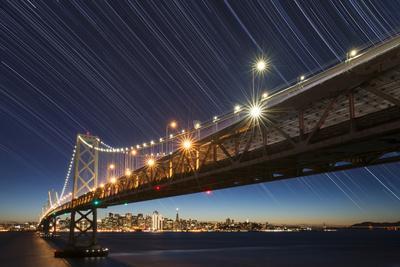 California, San Francisco. Composite of Star Trails Above Bay Bridge