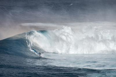 Hawaii. Maui. Lone Windsurfer on Monster Waves at Pe'Ahi Jaws, North Shore Maui