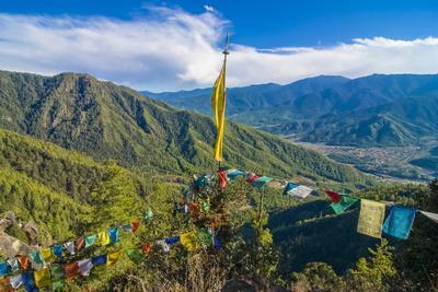 Praying Flags before the Tiger's Nest, Taktsang Goempa Monastery Hanging in the Cliffs, Bhutan