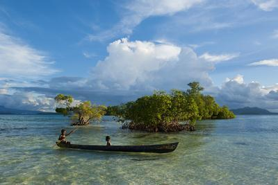 Young Boys Fishing in the Marovo Lagoon before Dramatic Clouds, Solomon Islands, South Pacific