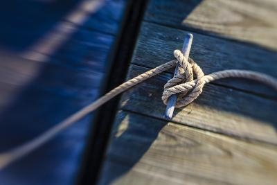 Rope Tied to a Dock in Pamet Harbor in Truro, Massachusetts. Cape Cod