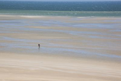 Africa, Western Sahara, Dakhla. Trist Walking Along the Beach of the Atlantic
