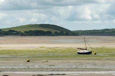 A Boat Moored at Low Tide in the River Camel Estuary at Padstow Cornwall UK