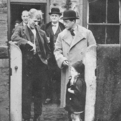 The Prince of Wales visiting a miners cottage in the Northeast of England, 1929 (1936)