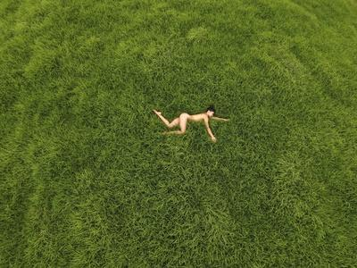 A Nude Woman Resting in the Grass Photographic Print