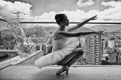 Ballerina Balancing on a Rooftop in Medellin