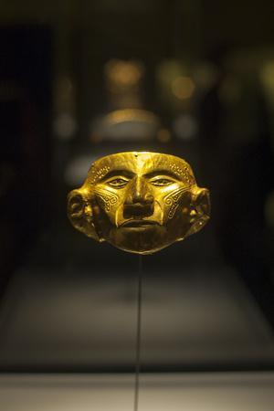A Gold Mask in a Display Case at the Gold Museum in Bogota, Colombia