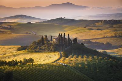 Podere Belvedere, San Quirico D'Orcia, Tuscany, Italy. Sunrise over the Farmhouse and the Hills.