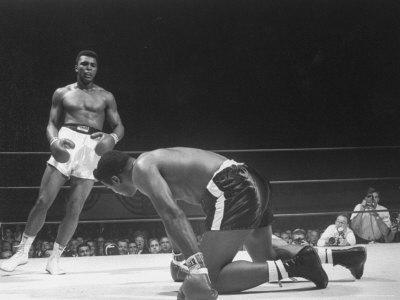 Cassius Clay Dancing Around Ring, Looking at Floyd Patterson, Whom He Has Just Knocked Down