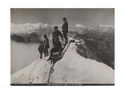 Jungfrau, Bernese Oberland, Switzerland. Climbers Rest and Observe the View from Summit of Jungfrau