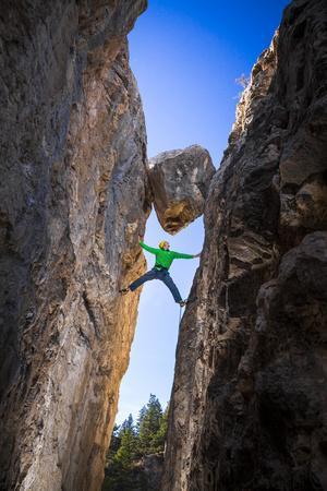 Kyle Vassilopoulos Having Fun Climbing Below A Large Chock Stone Slot Canyon At Natural Bridge SP