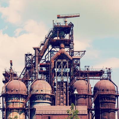 Building a Blast Furnace at the Steel Industry on a Background of Blue Sky