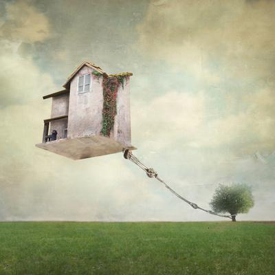 Artistic Image Representing an House Floating in the Air Tied to a Rope to the Tree in a Surreal Vi