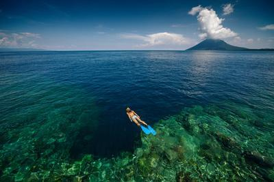 Young Lady Snorkeling over the Reef Wall in the Area of the Island of Bunaken, Sulawesi, Indonesia
