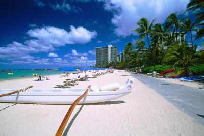 Beach Umbrellas and Outrigger Canoe