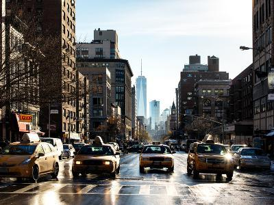 Urban Street Scene with NYC Yellow Taxis and the One World Trade Center of Manhattan in Winter