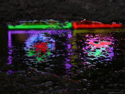 Abstracted Colors Reflect From Restaurant Lights on a Slushy Street