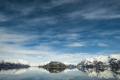 Snow Capped Mountains Rise Out of the Tidewater Bay of Glacier Bay