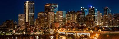 Illuminated bridge and skylines in a city, Center Street Bridge, Bow River, Calgary, Alberta, Ca...
