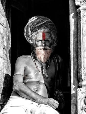A black and white picture of a sadhu (yogi) at Pashupatinath Temple in Kathmandu, Nepal