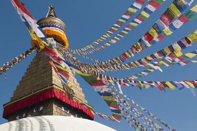 Bouddha (Boudhanath) (Bodnath) in Kathmandu is covered in colourful prayer flags, Kathmandu, Nepal